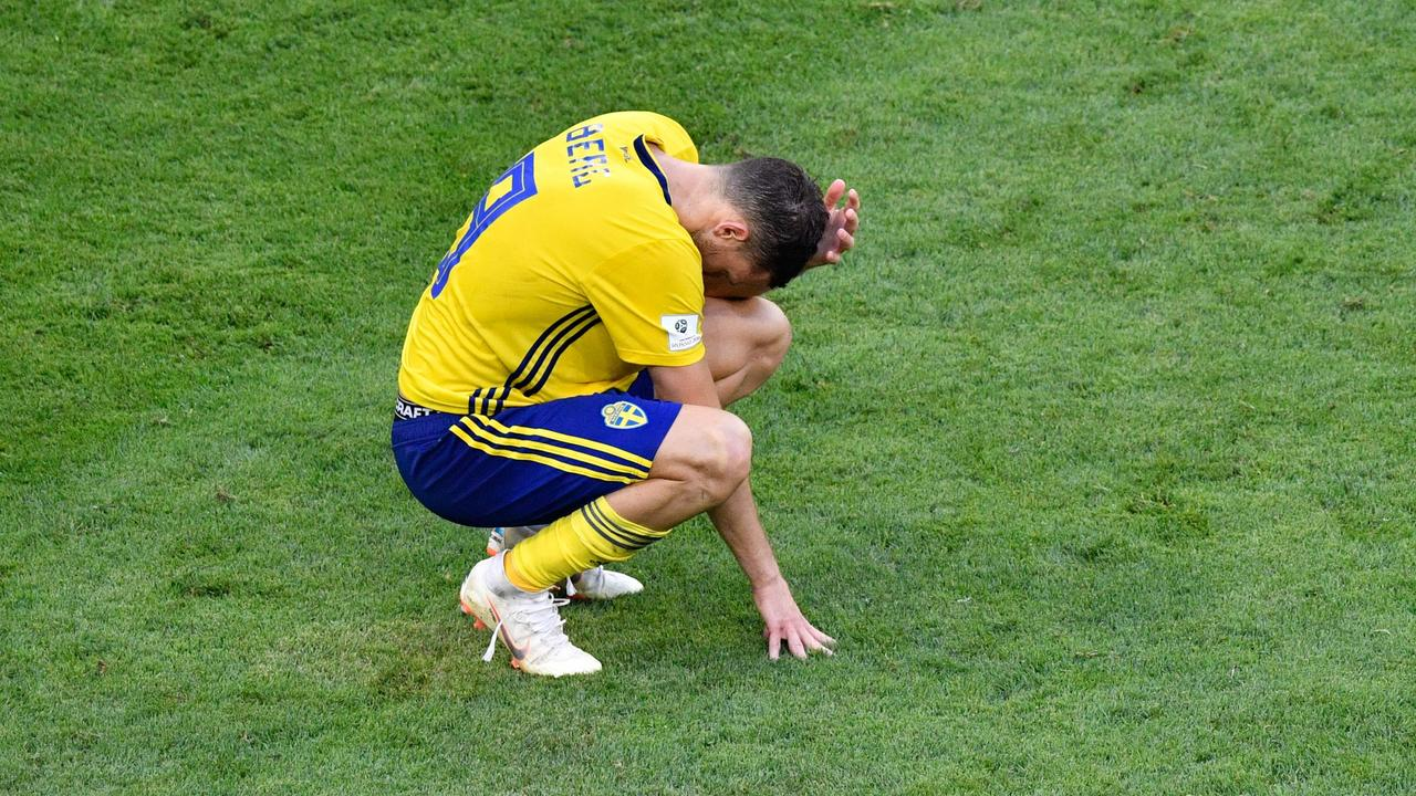 Sweden's forward Marcus Berg reacts after losing to England.