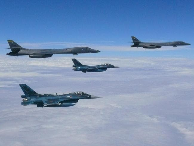 Two Air Force B-1B Lancers fly from Andersen Air Force Base, Guam, for a 10-hour mission to the vicinity of Kyushu, Japan, the East China Sea, and the Korean Peninsula on Monday. Picture: AFP/US Air Force