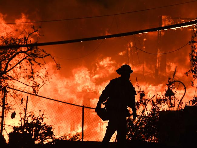 Climate-linked disasters such as the California fires are expected to cause growing losses to American infrastructure and property and impede the rate of economic growth. Picture: AFP