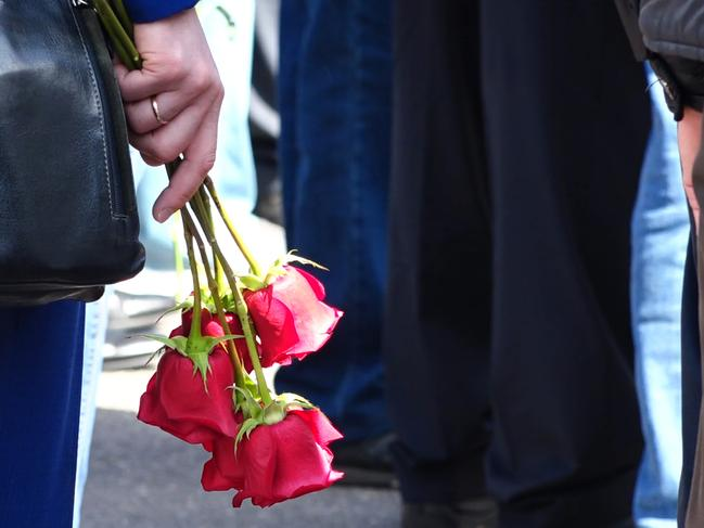A woman holds roses at the August 12 funeral of those killed in the blast. Picture: Russian State Atomic Energy Corporation Rosatom via AP