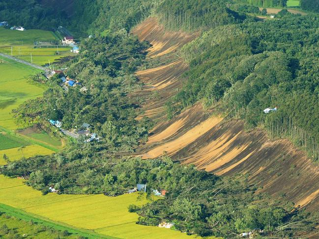 This picture shows an aerial view of houses damaged by a landslide in Atsuma town, Hokkaido prefecture. Picture: JIJI PRESS / AFP