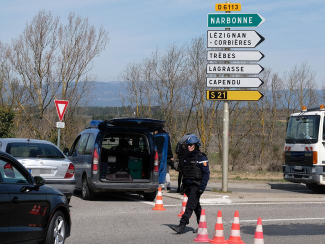 French gendarmes block the access to Trebes, where a man took hostages at a supermarket in Trebes, southwest France. Picture: AFP