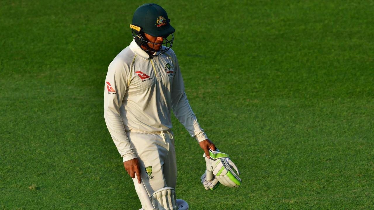 Usman Khawaja will have knee surgery. Picture: AFP