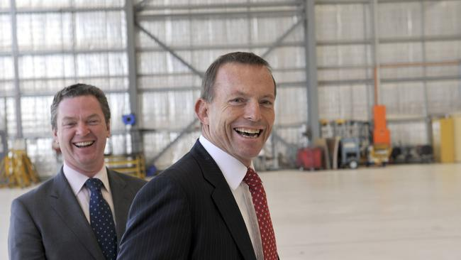 Tony Abbott laughs it up with Christopher Pyne during a visit to Rex Airlines in Adelaide.