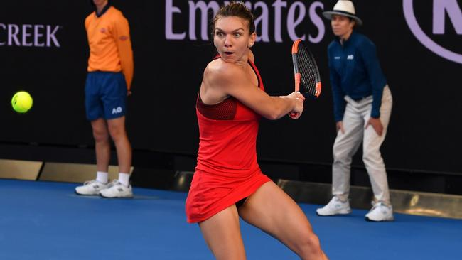 Romania's Simona Halep plays a backhand return to Japan's Naomi Osaka  during their women's singles fourth