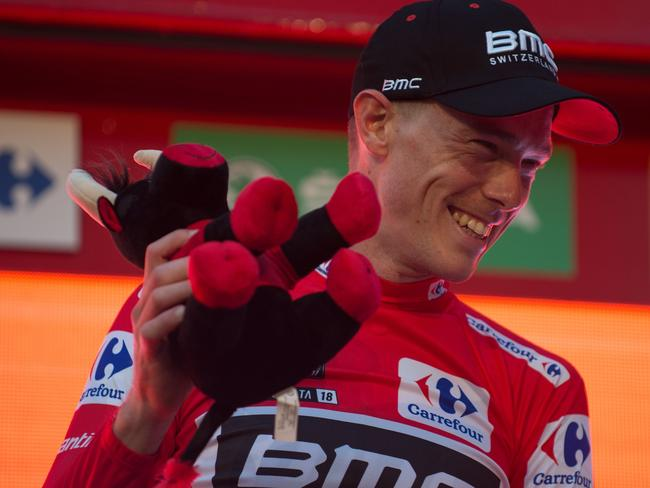 """BMC Racing Team's Australian cyclist Rohan Dennis smiles on the podium as he celebrates winning the first stage of the 73rd edition of """"La Vuelta"""" Tour of Spain. Picture: AFP"""