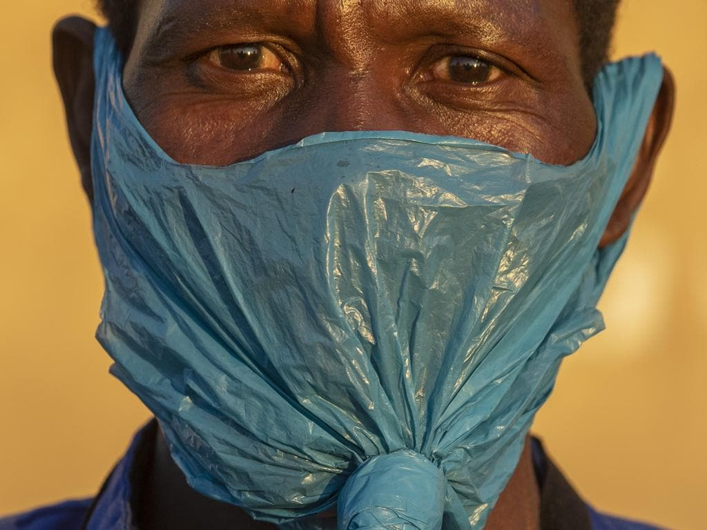 A man wears a plastic bag on his face as a precaution against the spread of coronavirus in Johannesburg, South Africa. Picture: AP Photo/Themba Hadebe