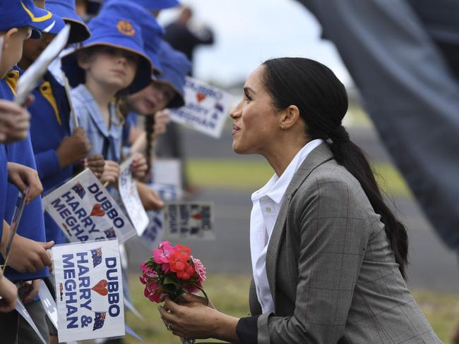 Meghan was all smiles as they met schoolkids in Dubbo. Picture: Dean Lewins/AFP