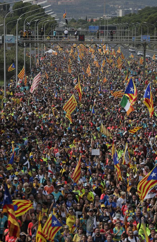 Protesters march on the streets of Barcelona. Picture: AP