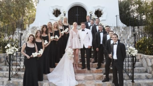 The bride and groom and their 14-strong bridal party. Source:Supplied