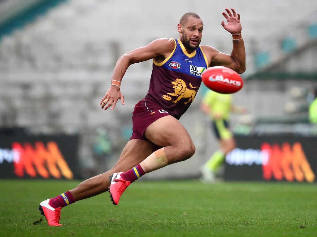 Cameron Ellis-Yolmen chases the ball while playing his former side, Adelaide, at The Gabba. Picture: JONO SEARLE/AFL PHOTOS/VIA GETTY IMAGES