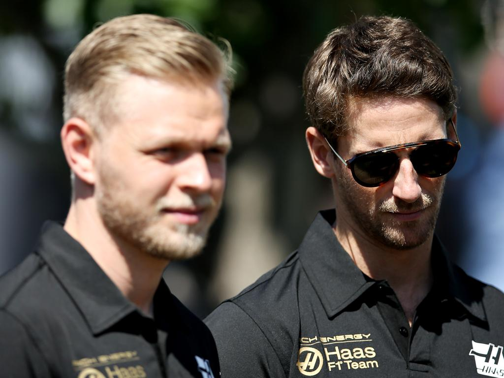 MELBOURNE, AUSTRALIA - MARCH 14: Romain Grosjean of France and Haas F1 and Kevin Magnussen of Denmark and Haas F1 look on in the Paddock during previews ahead of the F1 Grand Prix of Australia at Melbourne Grand Prix Circuit on March 14, 2019 in Melbourne, Australia. (Photo by Charles Coates/Getty Images)