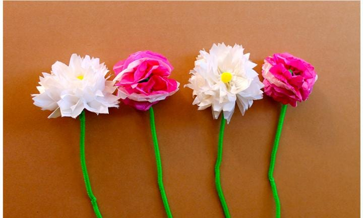 "These are ingenious because you can change the flower you make just by changing the way you snip the ends. You can make roses, sweet peas, chrysanthemums, daisies and more. How many varieties can you create with this simple fold-and-snip method?  <a href=""https://www.youtube.com/watch?v=4sV055oKFZ0 "">Tissue paper flowers</a>"
