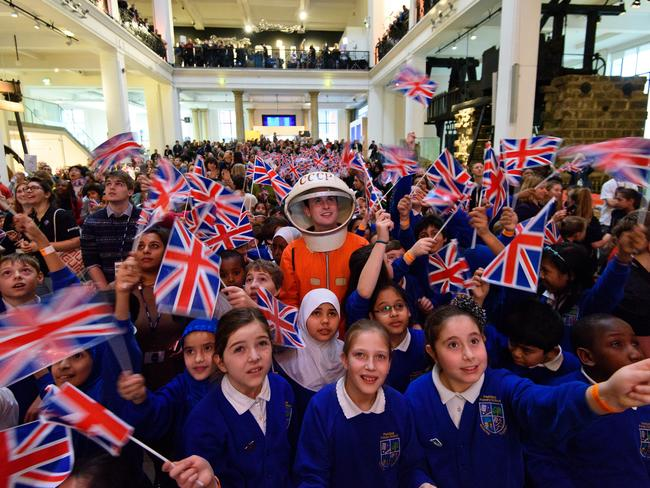 Patriotic ... students gather at the Science Museum ahead of the launch of space mission Principia from Baikonur Cosmodrome in Kazakhstan. Picture: Ben Pruchnie/Getty Images