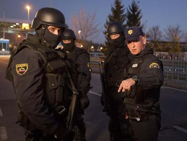 Tensions heightened ... Slovenian police communicate on the Croatian border in Rigonce, Slovenia.