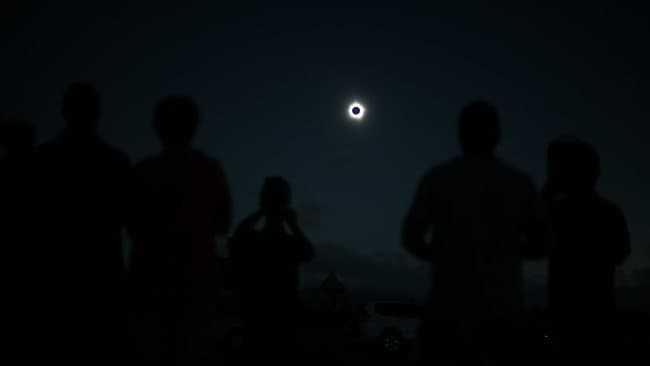 Eclipse FNQ: an hour after sunrise, the moon obscured the sun and Far North Queensland was plunged back into darkness. Picture: Marc McCormack