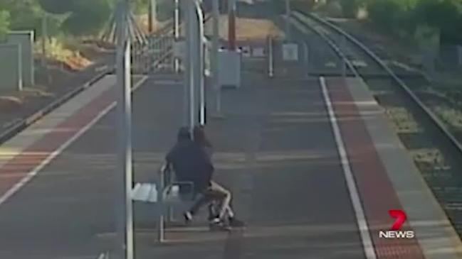 Lucas Narkle drags girlfriend towards train (7 News Adelaide)