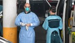 BRISBANE, AUSTRALIA - NewsWire Photos - JANUARY 13, 2021. Ambulance crews prepare to transport quarantined guests from the Hotel Grand Chancellor in Spring Hill, Brisbane. Guests will be evacuated after six people linked to the building tested positive to the highly-contagious UK variant of the coronavirus. Picture: NCA NewsWire / Dan Peled