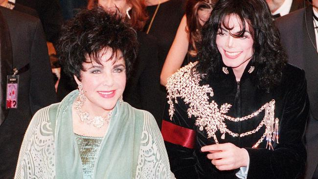 Elizabeth Taylor with singer Michael Jackson at her 65th birthday celebrations. Picture: Getty