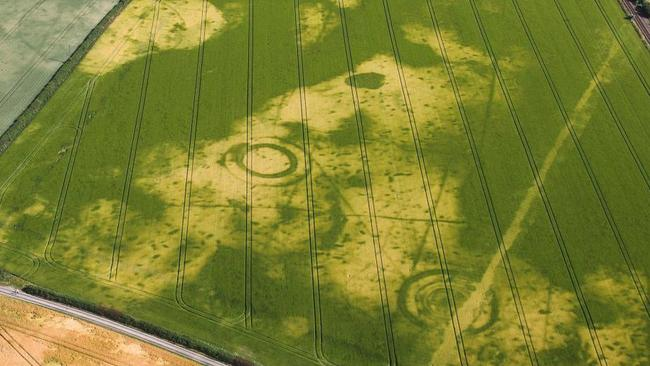 The hot weather has unveiled some of Britain's hidden history like this Roman village near Norwich. Picture: SWNS/Mega