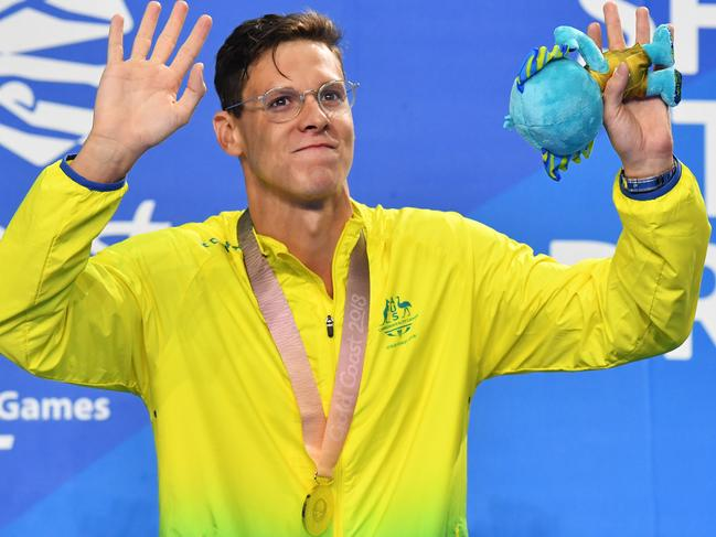 Mitch Larkin celebrates winning gold in the 100m backstroke.