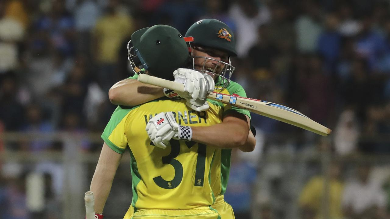 Australia's captain Aaron Finch and David Warner celebrate the win.