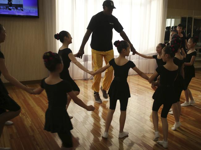 Former NBA basketball star Dennis Rodman dances with schoolchildren at the Mangyongdae School Children's Palace last week while in Pyongyang, North Korea. Picture: AP Photo/Kim Kwang Hyon