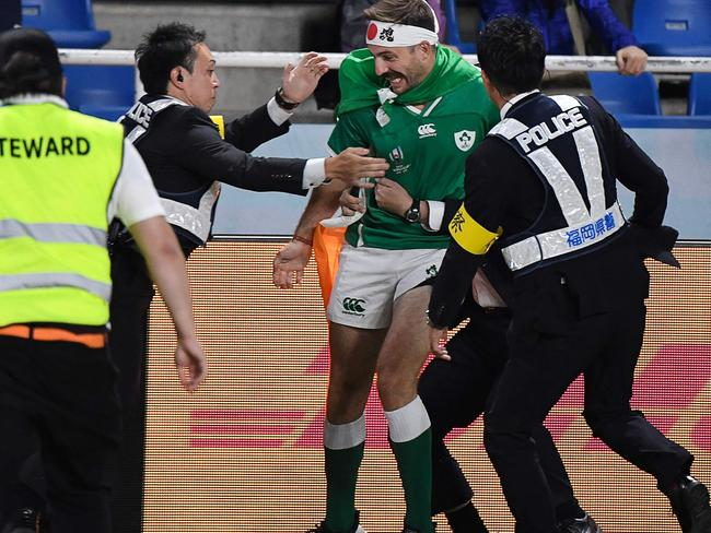 An Irish pitch invader's run comes to an end. Picture: AFP