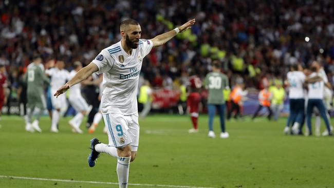 "Real Madrid's Karim Benzema celebrates after his team won the Champions League Fina  <a class=""capi-image"" capiid=""c2e5066f574f9c9800d9d78c07b730a8""></a>"