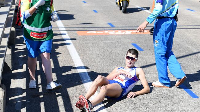 Callum Hawkins of Scotland as he collapses after being in the lead of the Men's Marathon Final on day eleven of competition at the XXI Commonwealth Games on the Gold Coast. Picture: AAP