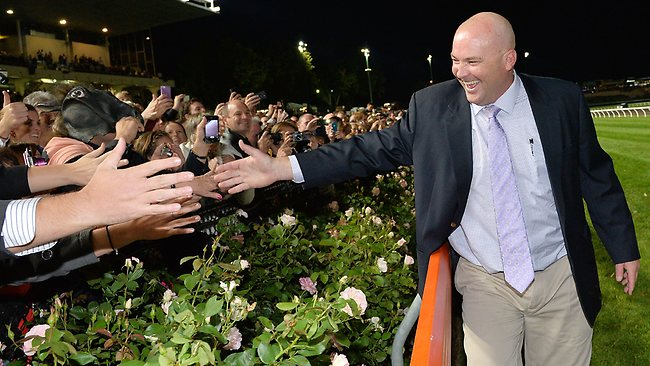 Trainer Peter Moody celebrates with the crowd after Black Caviar's 24th straight win.