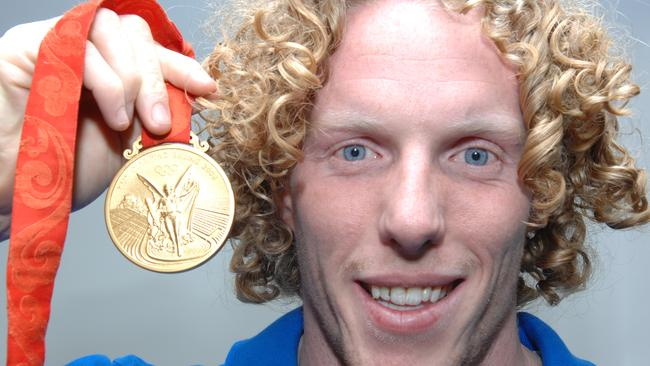 Steve Hooker with his Olympic gold medal.