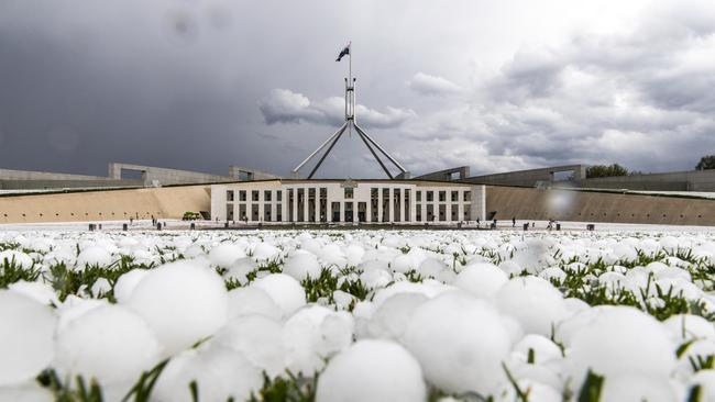 Hailstones littered the lawn outside Parliament House. Picture: AUSPIC/David Foote