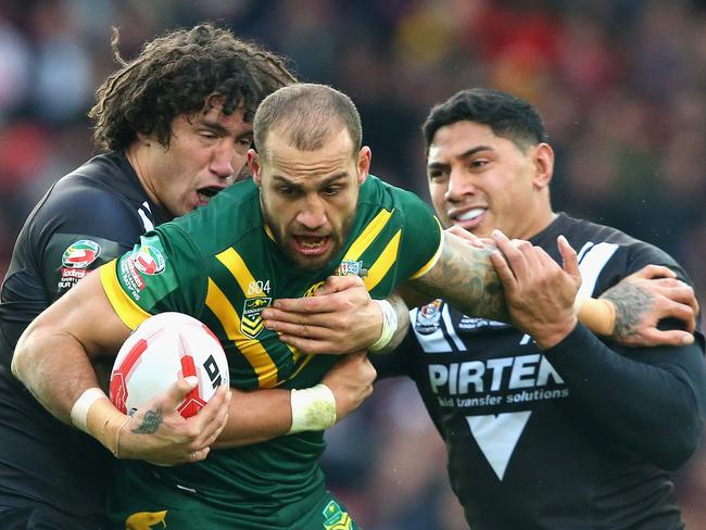 Blake Ferguson is tackled by Kevin Proctor (L) and Jason Taumalolo of New Zealand during the Four Nations Final between New Zealand and Australia.