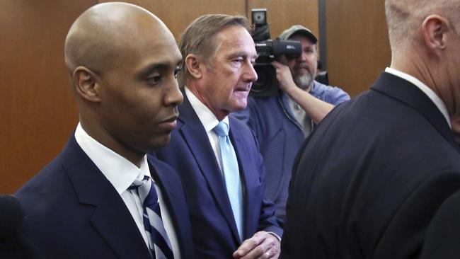 Former Minneapolis cop Mohamed Noor (left) leaves the Hennepin County Government Center after pleading not guilty. Picture: AP Photo/Jim Mone