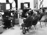 Students watch a career film at the Careers Reference Centre in Gawler Place, 1977.