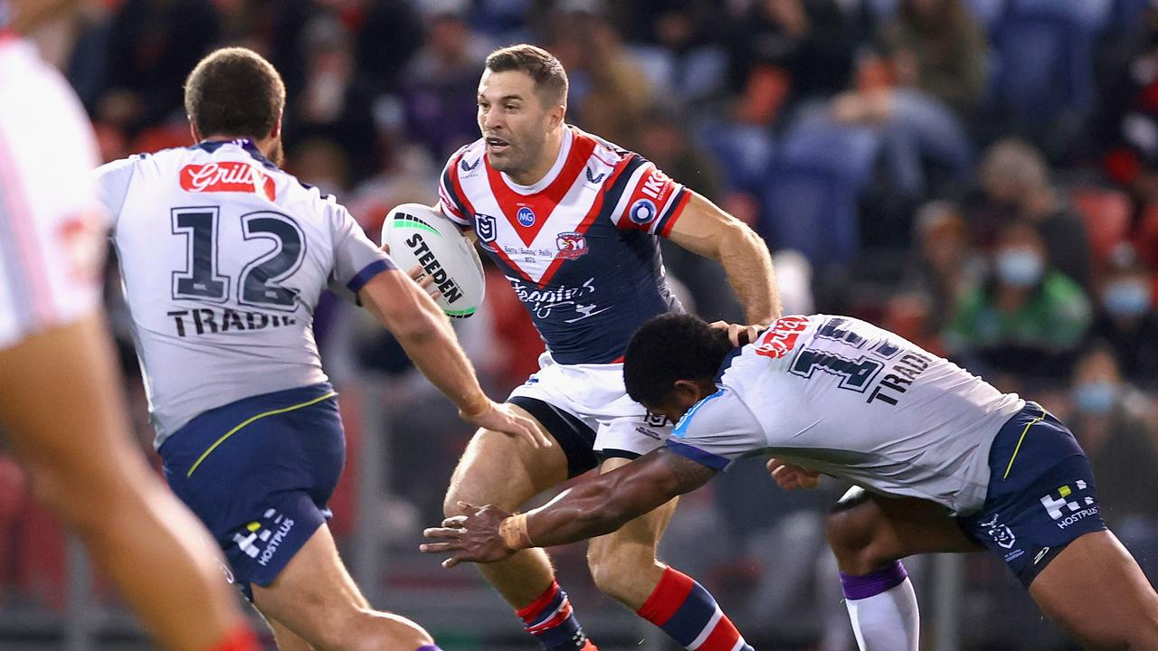 NEWCASTLE, AUSTRALIA – JULY 01: James Tedesco of the Roosters is tackled during the round 16 NRL match between the Sydney Roosters and the Melbourne Storm at McDonald Jones Stadium, on July 01, 2021, in Newcastle, Australia. (Photo by Ashley Feder/Getty Images)