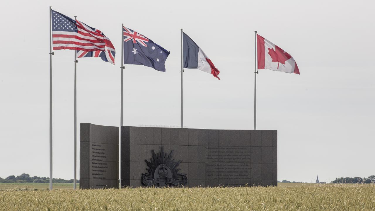 Australian memorial at Le Hamel, France, showing US, UK, Australian, French and Canadian flags to represent the countries of the soldiers who helped take the village back for the French people. Picture: Ella Pellegrini