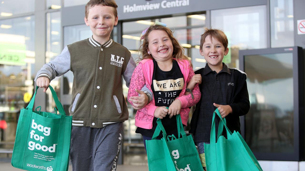 Cooper, Savannah and Kody are shopping with reusable bags, which they will need to turn inside out, wash and dry to keep clean. Picture: AAP
