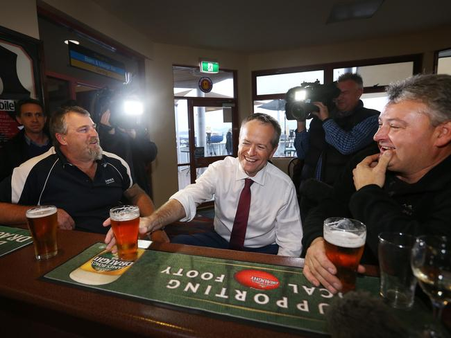 Labor leader Bill Shorten has a beer with Beaconsfield Mine disaster survivors Todd Russell and Brant Webb at the Beauty Point Waterfront Hotel. Picture: Chris Kidd