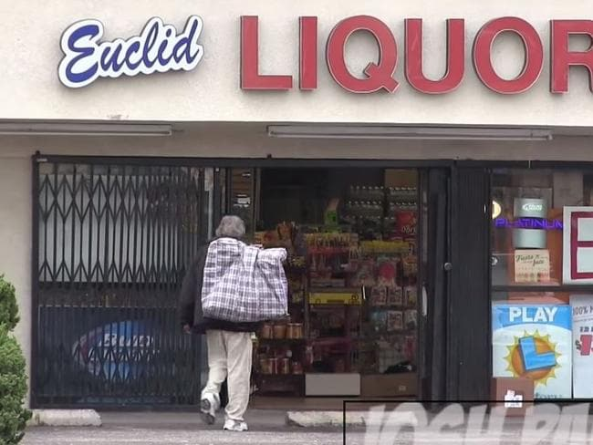 Ready to spend ... the homeless man was filmed walking into a liquor shop. Picture: YouTube/Josh Paler Lin