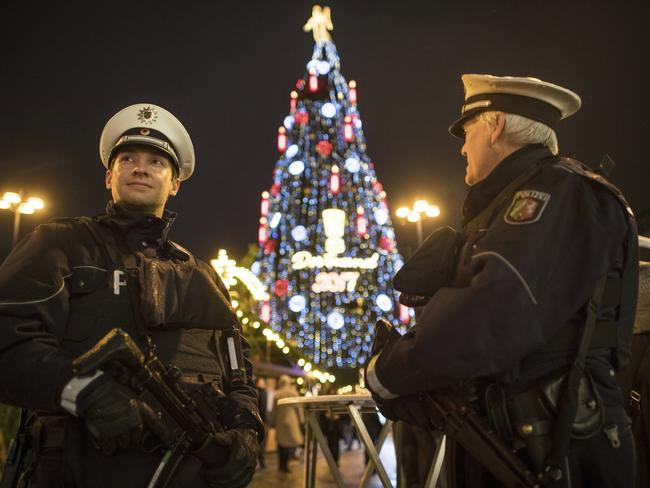 armed police forces stand in front of the worlds largest christmas tree according to the - Worlds Largest Christmas Tree