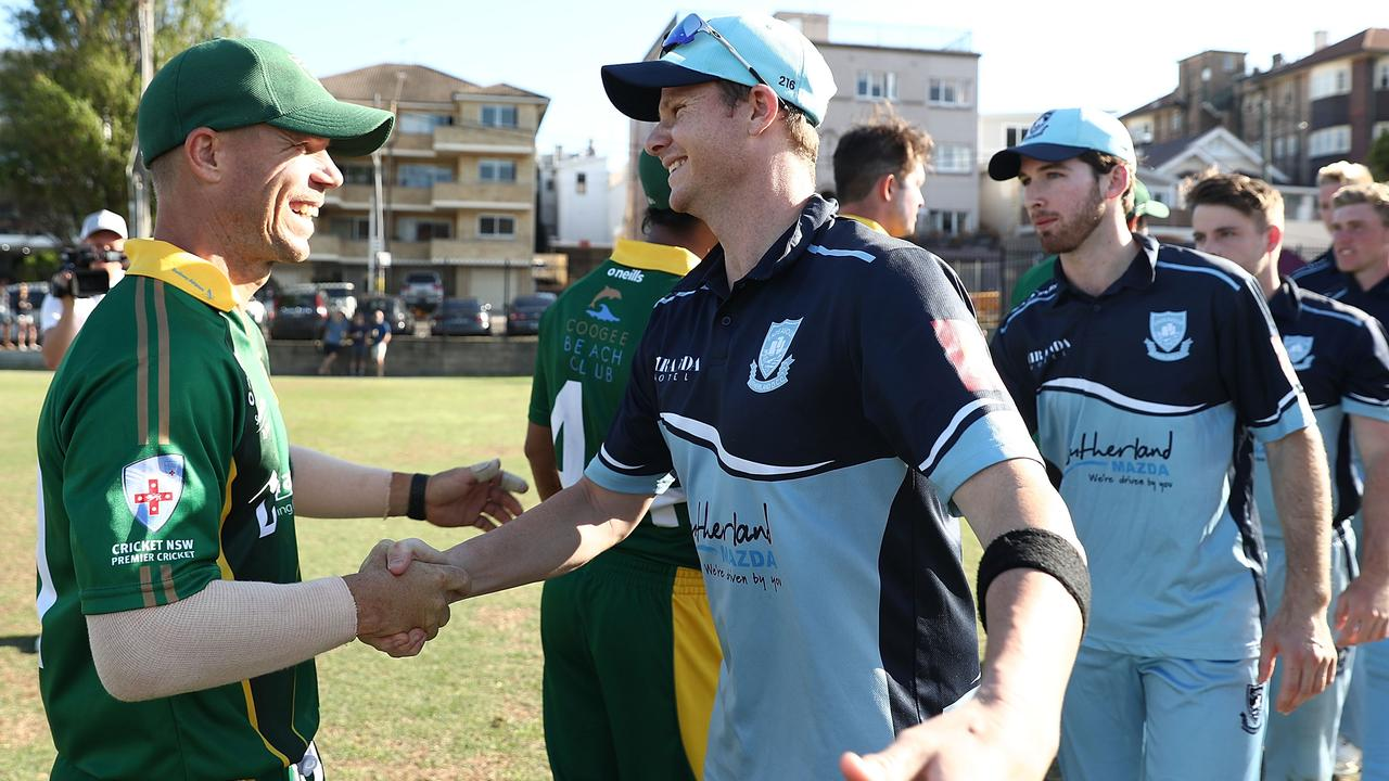David Warner and Steve Smith are all smiles as they shake hands.