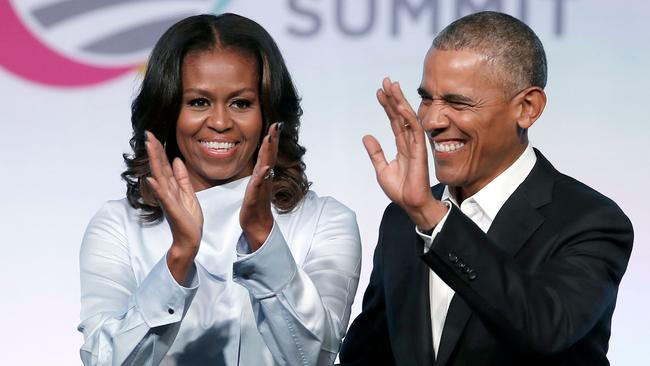 The Obamas scored a staggering $A82.9 million book deal. Picture: Jim Young/AFP