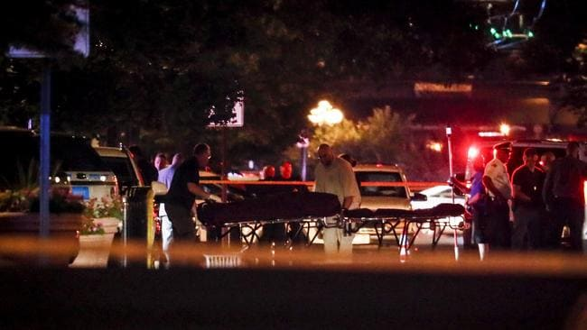 Bodies are removed from the scene of the mass shooting in Dayton, Ohio. Picture: AP