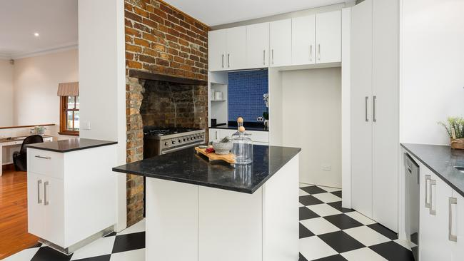 The exposed brick also remains a feature in the kitchen.