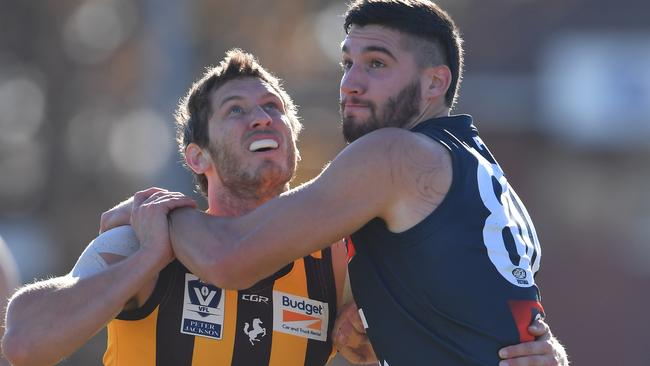 Tyrone Vickery battles Matthew Korcheck in the VFL this season.