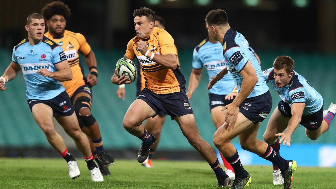 Tom Banks of the Brumbies makes a break to score a try against the Waratahs. (Photo by Mark Metcalfe/Getty Images)