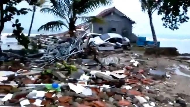 Daylight has revealed the extent of destruction caused by a tsunami in Indonesia.