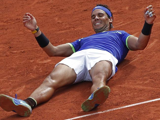 Nadal celebrates winning his tenth French Open title.